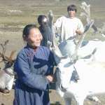 Shaman and white reindeer
