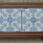 Antique Delft tiles with inlaid walnut frame