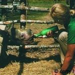 Rhino calf feeding by Iris Hunt 1973