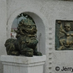 Lion/woman chimera & lion statue